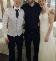 chris the wedding singer posing with the wedding couple